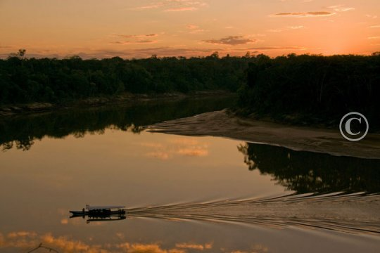 The Tambopata River with the lodge boat